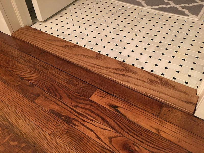 If Hardwood Planks Lie Perpendicular To A Tile Floor Short Cut Ends Border The It S Usually Best Wood In Its Own Material 1 2 Rows