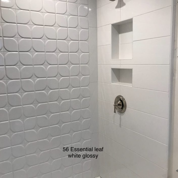 white glossy textured tile used as accent wall in shower