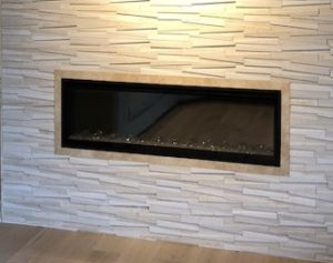 fireplace with textured tile surround